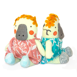 A pair of Annie Dolls on a white background